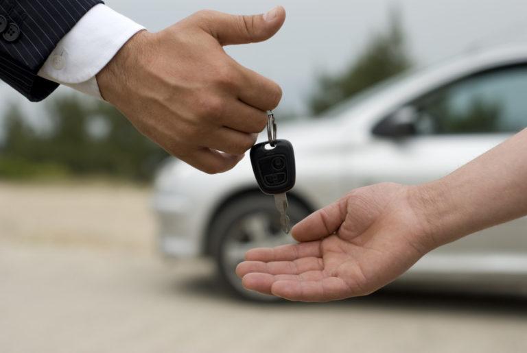 handing a car key