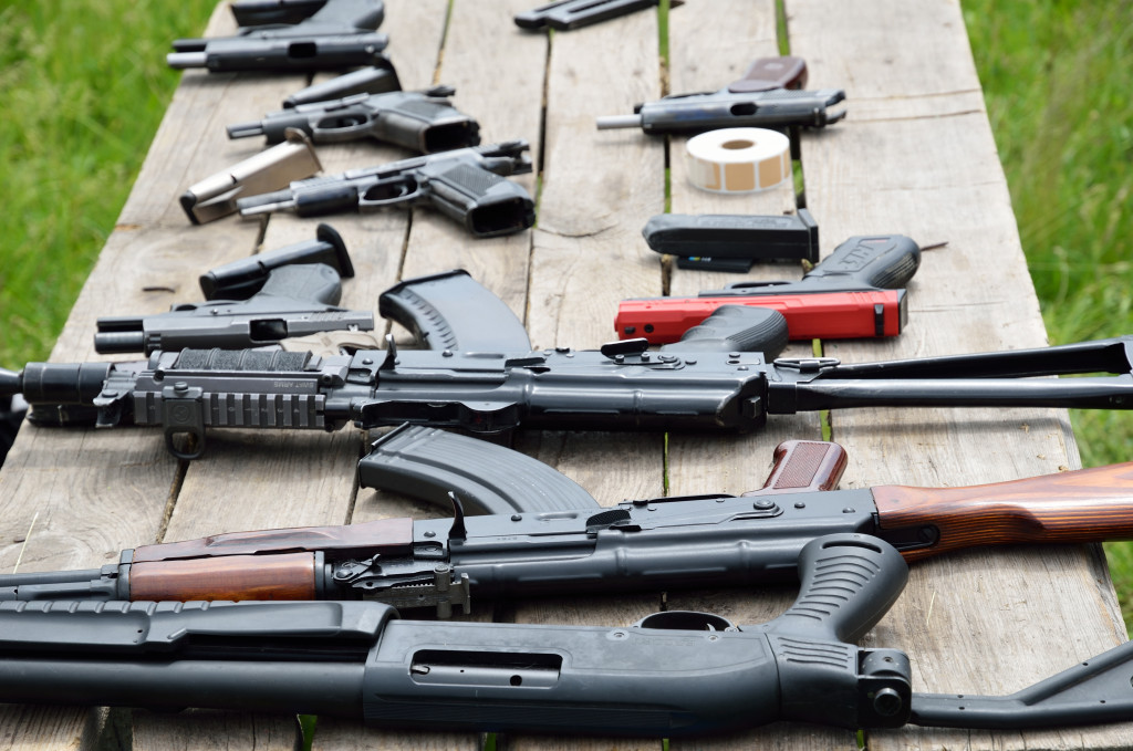 table filled with guns