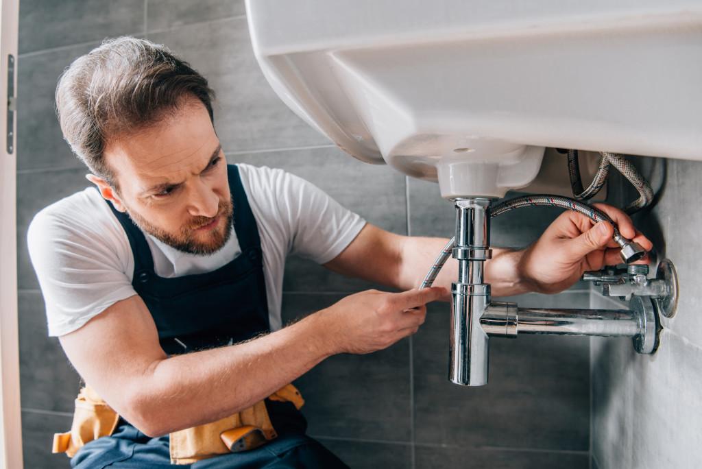 man doing sink repair