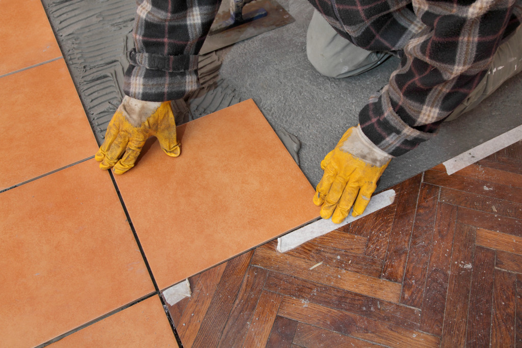 person doing the flooring