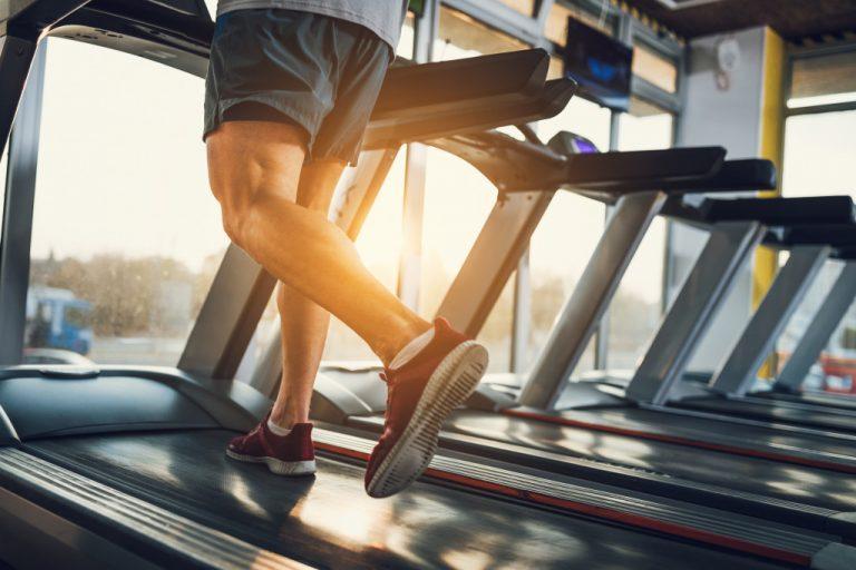man running in treadmill in sports facility